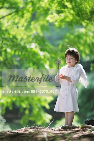 Boy Holding Magic Wand Stock Photo - Rights-Managed, Image code: 859-03781907