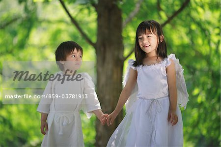 Angels Standing Together Holding Hands Stock Photo - Rights-Managed, Image code: 859-03781913