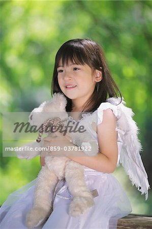 Girl Holding Teddy Bear Stock Photo - Rights-Managed, Image code: 859-03781922