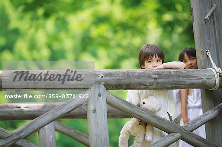 Boy Standing Holding Teddy Bear Stock Photo - Rights-Managed, Image code: 859-03781926