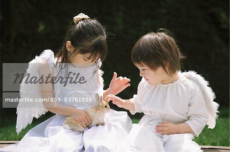 Children Playing with Rabbit Stock Photo - Rights-Managed, Image code: 859-03781936