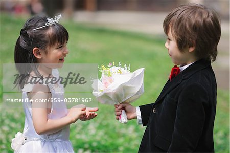 Boy Offering  Flowers to Girl Stock Photo - Rights-Managed, Image code: 859-03781962