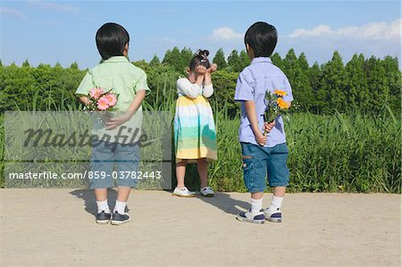 Boys Holding Flowers for Girl Stock Photo - Rights-Managed, Image code: 859-03782443