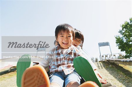 Children Playing In Playground Stock Photo - Rights-Managed, Image code: 859-03805766