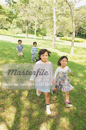 Children Having Fun in Park Stock Photo - Rights-Managed, Image code: 859-03805850