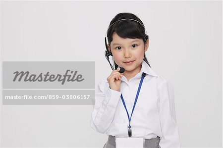 Portrait of Girl as Office Worker Wearing Headset Stock Photo - Rights-Managed, Image code: 859-03806157
