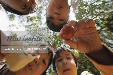 Children with Food in Hand Stock Photo - Rights-Managed, Image code: 859-03806222