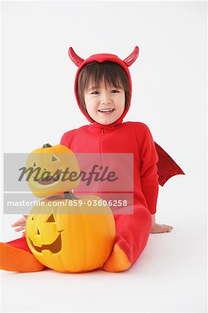 3 Year Boy Dressed Up As Devil with Pumpkins Stock Photo - Rights-Managed, Image code: 859-03806258