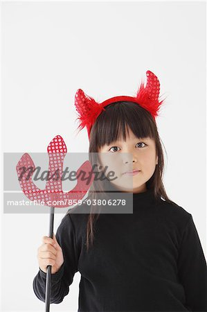 Girl Dressed In Halloween Costume as Devil Stock Photo - Rights-Managed, Image code: 859-03806278