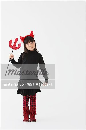 Girl Dressed In Halloween Costume as Devil Stock Photo - Rights-Managed, Image code: 859-03806279
