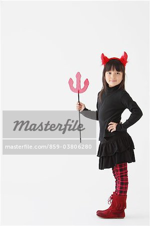 Girl Dressed In Halloween Costume as Devil Stock Photo - Rights-Managed, Image code: 859-03806280