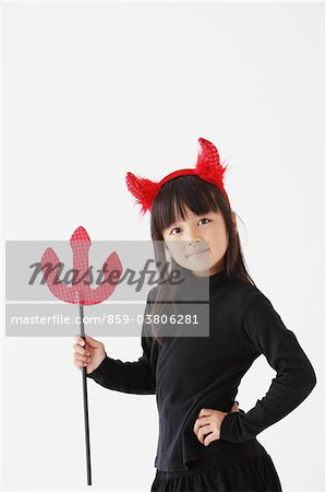 Girl Dressed In Halloween Costume as Devil Stock Photo - Rights-Managed, Image code: 859-03806281