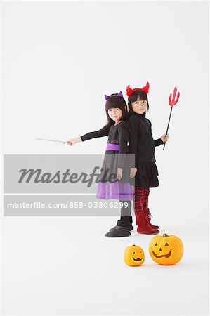 Two Girl Dressed In Halloween Costume Stock Photo - Rights-Managed, Image code: 859-03806299