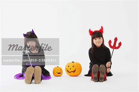 Two Girl Dressed In Halloween Costume Stock Photo - Rights-Managed, Image code: 859-03806301