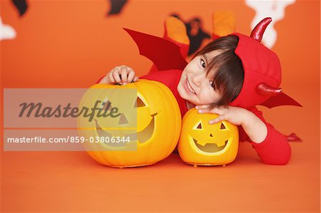 Boy Dressed Up As Devil against Orange Background Stock Photo - Rights-Managed, Image code: 859-03806344