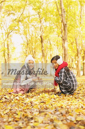 Girls Playing In The Autumn Leaves Stock Photo - Rights-Managed, Image code: 859-03839336