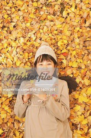 Preteen Girl Lying In Leaves Stock Photo - Rights-Managed, Image code: 859-03839369