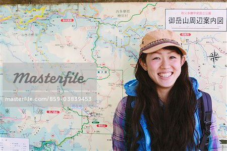 Backpack Woman Smiling Against Route Map Stock Photo - Rights-Managed, Image code: 859-03839453
