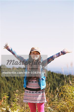 Young Woman Enjoying Nature Arm Raised Stock Photo - Rights-Managed, Image code: 859-03839459