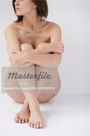 Naked Woman Hugging Knees Stock Photo - Rights-Managed, Image code: 859-03839974