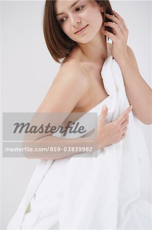 Beautiful Young Woman Covering Breast With Towel Stock Photo - Rights-Managed, Image code: 859-03839982