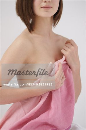 Beautiful Young Woman Covering Breast With Towel Stock Photo - Rights-Managed, Image code: 859-03839983