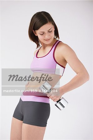 Woman Lifting Weights Stock Photo - Rights-Managed, Image code: 859-03840004