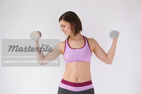 Woman Lifting Weights Stock Photo - Rights-Managed, Image code: 859-03840006