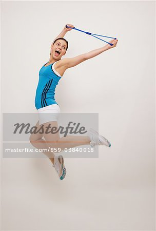 Young Woman Jumping Stock Photo - Rights-Managed, Image code: 859-03840018