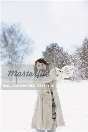 Teenage Girl Throwing Snow Stock Photo - Rights-Managed, Image code: 859-03860626