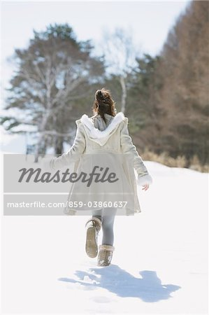Teenage Girl Walking Alone In Snow Stock Photo - Rights-Managed, Image code: 859-03860637