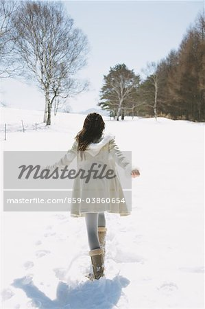 Girl Hanging Out In Snow Stock Photo - Rights-Managed, Image code: 859-03860654