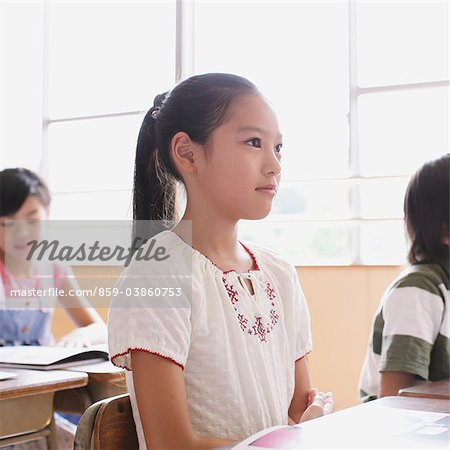 Schoolgirl Paying Attention In Classroom Stock Photo - Rights-Managed, Image code: 859-03860753