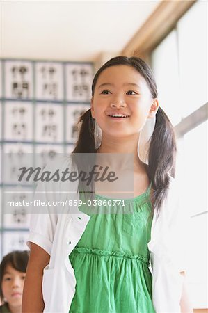Schoolgirl Answering In Classroom Stock Photo - Rights-Managed, Image code: 859-03860771