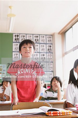 Japanese Schoolboy Answering In Classroom Stock Photo - Rights-Managed, Image code: 859-03860788