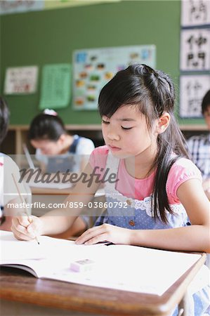 Japanese Girl Learning Stock Photo - Rights-Managed, Image code: 859-03860792