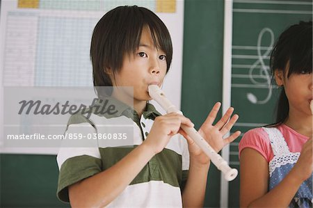 Schoolchildren Playing Flute Stock Photo - Rights-Managed, Image code: 859-03860835