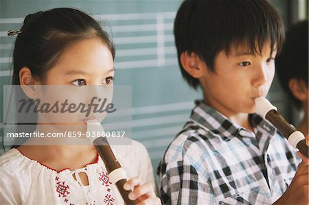 School Children Playing Flute Stock Photo - Rights-Managed, Image code: 859-03860837