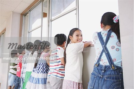 Children Looking Out Through A Window Stock Photo - Rights-Managed, Image code: 859-03860855