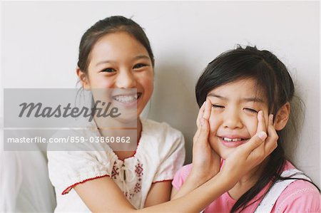 Girl Rubs Eyes Of Her Friend Who Is Crying Stock Photo - Rights-Managed, Image code: 859-03860862