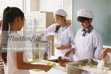 Student Serving Food In Classroom Stock Photo - Rights-Managed, Image code: 859-03860896