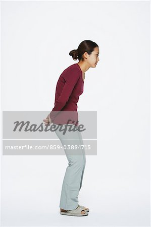 Young Woman Bending, Studio Shot Stock Photo - Rights-Managed, Image code: 859-03884715
