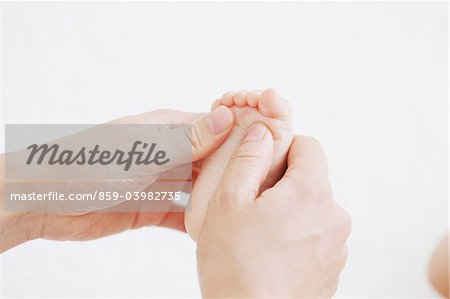 Mother Touching Baby's Foot Stock Photo - Rights-Managed, Image code: 859-03982735