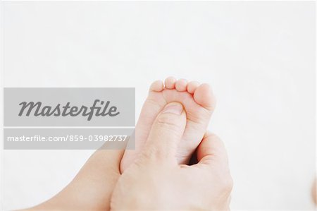Mother Touching Baby's Foot Stock Photo - Rights-Managed, Image code: 859-03982737