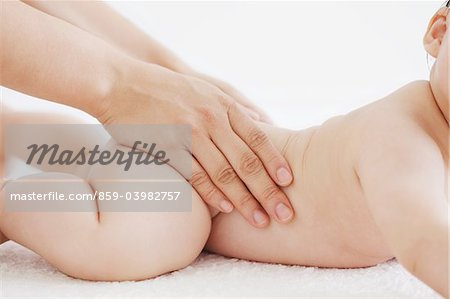Mother Massaging Baby Stock Photo - Rights-Managed, Image code: 859-03982757