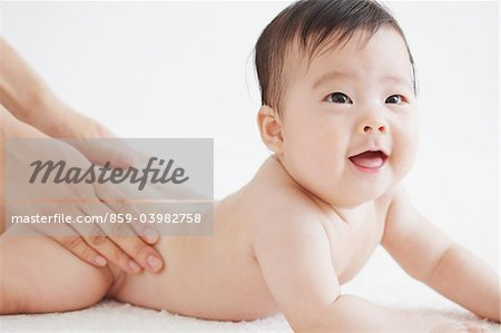 Mother Massaging Baby Stock Photo - Rights-Managed, Image code: 859-03982758
