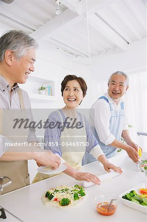 Three senior adult people attending a cooking class in an open kitchen Stock Photo - Rights-Managed, Image code: 859-06469750