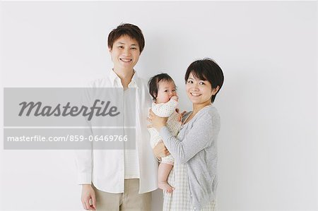 Young adult couple and son smiling at camera Stock Photo - Rights-Managed, Image code: 859-06469766