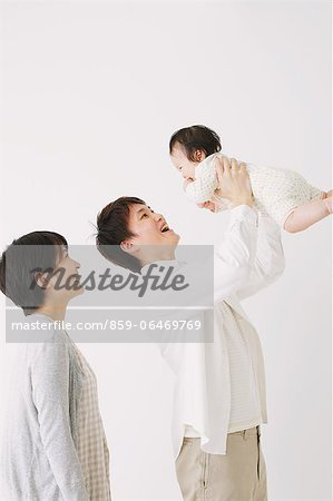 Young adult couple and son. Father lifting his son and smiling Stock Photo - Rights-Managed, Image code: 859-06469769