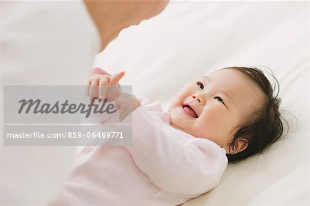 Close up of baby boy looking at his father and smiling Stock Photo - Rights-Managed, Image code: 859-06469771